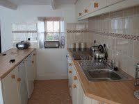 image of the kitchen in The Cottage & Littlecot self catering holiday let in perranuthnoe