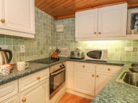 image of the kitchen in little place self catering holiday let in perranuthnoe